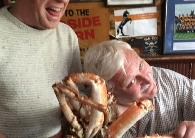 Enjoying the local food and sampling some crab on the Northern-Delights_tour